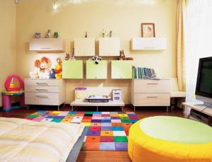Adorable-kids-bedroom-interior-design-with-colorful-rug-on-wooden-floor-as-well-round-table-beside-tv-on