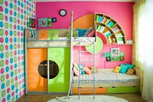 Colorful-kids-bedroom-interior-design-with-cicle-pattern-wallpaper-and-cool-bookcase-ideas-above-bed-als