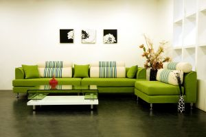 Interior-design-style-design-sofa-green-pillows-vases-table-painting-house-lounge